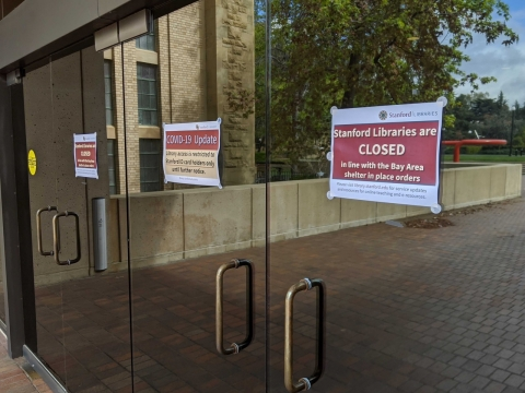 closed signs at the entrance of green library