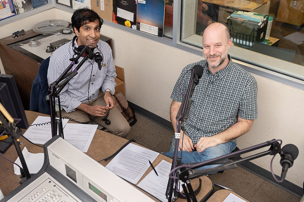 Ameet Doshi (right), director of innovation and program design and subject librarian at Georgia Tech's (GT) School of Public Policy and Law, and Charlie Bennett, public engagement librarian and subject librarian for GT's School of Economics, in GT's campus radio station. (Photo: Allison Carter/Georgia Institute of Technology)