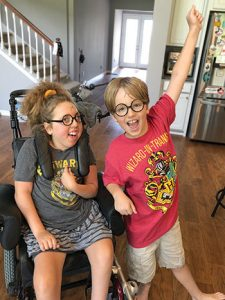 """Elena Ozment and her brother Joey celebrate completing the Harry Potter series. <span class=""""credit""""></noscript>Photo: Erin Ozment</span>"""" width=""""225″ height=""""300″ srcset=""""https://temilib.nasniconsultants.com/wp-content/uploads/2021/03/a-disproportionate-pandemic-1.jpg 225w, https://temilib.nasniconsultants.com/wp-content/uploads/2021/03/a-disproportionate-pandemic-4.jpg 350w"""" sizes=""""(max-width: 225px) 100vw, 225px""""><figcaption id="""