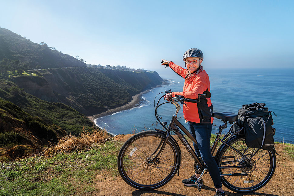 Monique Sugimoto, librarian and archivist for Palos Verdes Library District's Local History Center, points out over the coast. Photo: Erik Jay