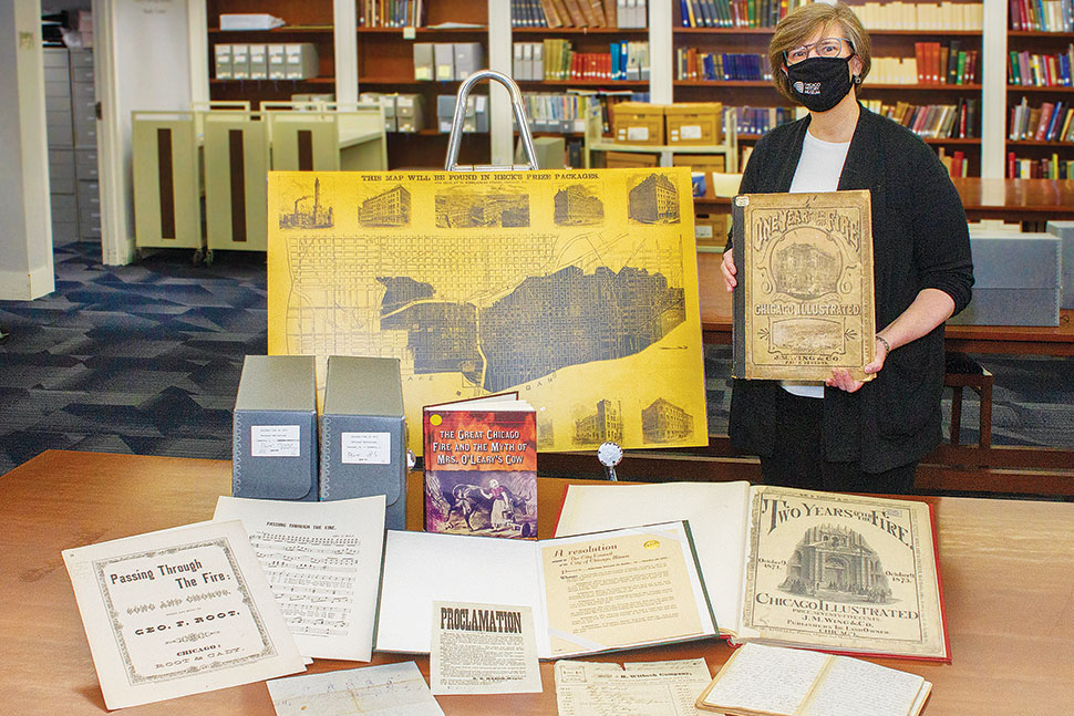 Ellen Keith, director of the Chicago History Museum Library, displays items related to the Great Chicago Fire. Photo by Rebecca Lomax/American Libraries