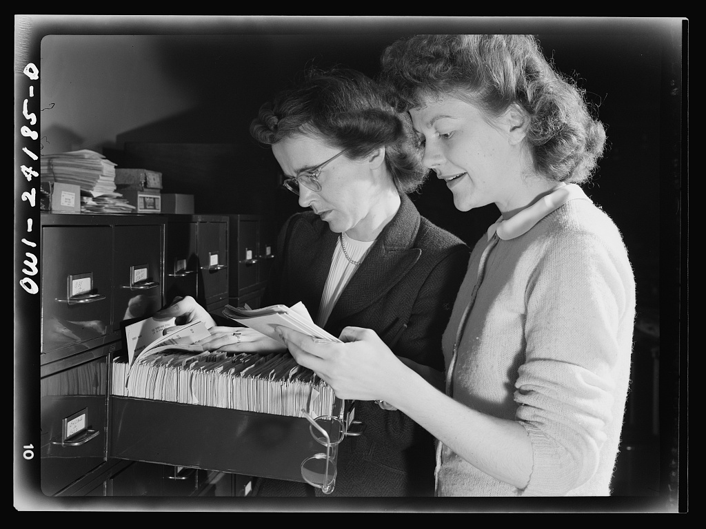 Rosener, Ann, photographer. Washington, D.C. OWI Office of War Information research workers. United States Washington D.C. District of Columbia Washington D.C, 1943. May. Photograph. //www.loc.gov/item/2017851714/